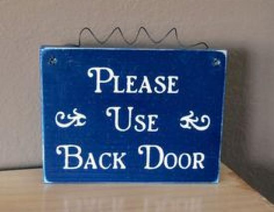 Please use Back Door, painted on sign.